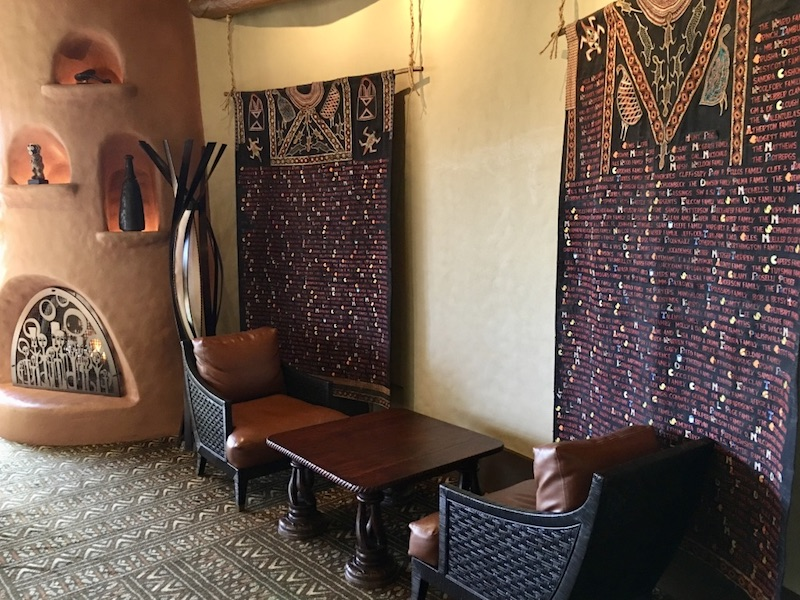 Founding Member tapestries and fireplace located in lounge