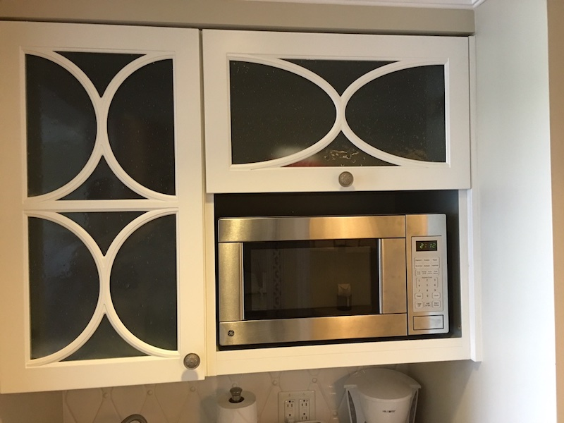 Kitchenette microwave and upper cabinets