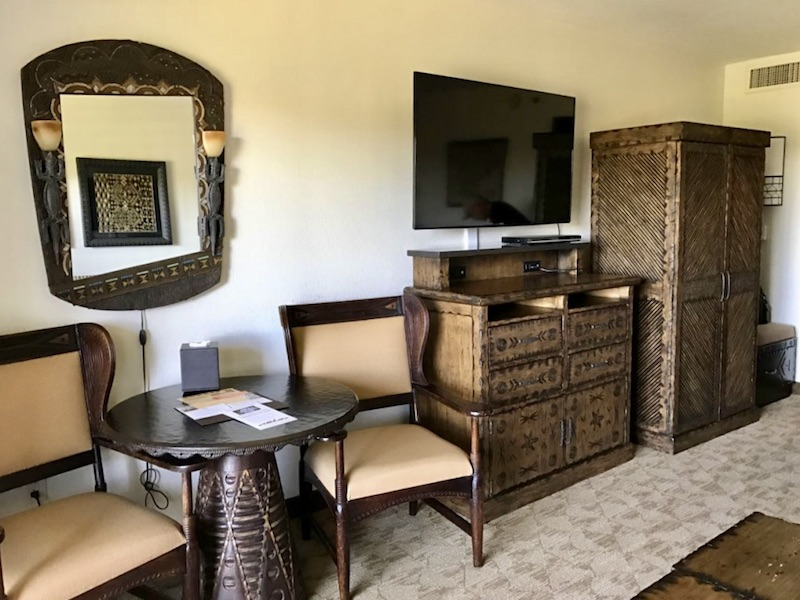 Side table with chairs, dresser, TV and armoire
