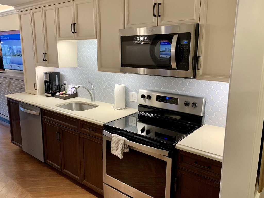 Kitchen cabinets, range, microwave, sink and dishwasher