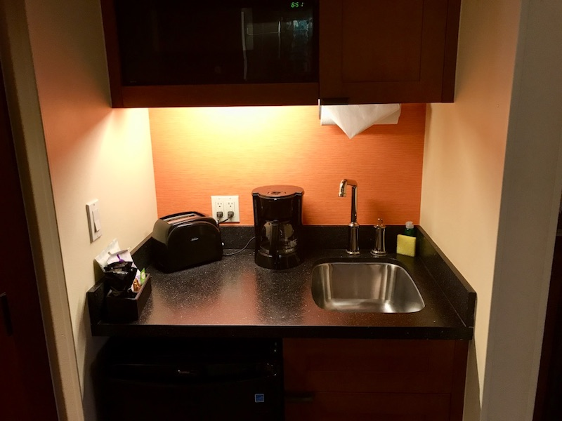 Kitchenette with bar sink, coffee maker and toaster