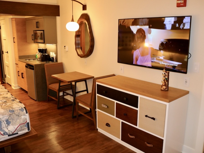 Flat panel TV, dresser, table & chairs, kitchenette (R-L)